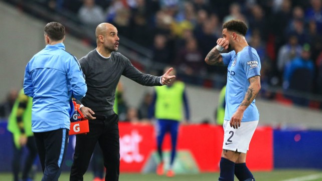 PEP TALK: The boss passes on instructions to Kyle Walker