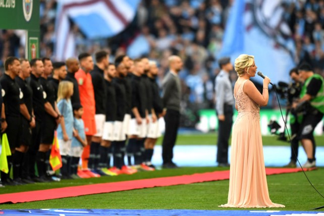 STIRRING STUFF: The national anthem is belted out prior to kick-off