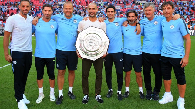 PEP TEAM: The coaching staff and the trophy