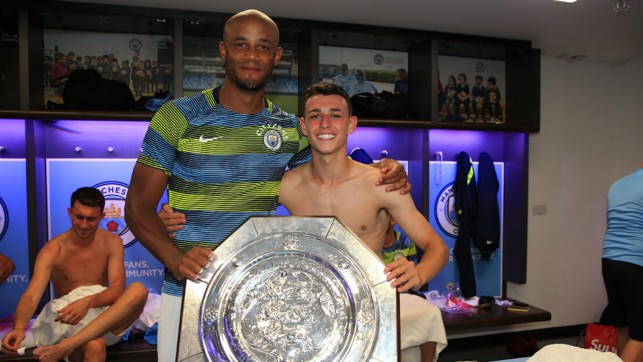 EXPERIENCE AND YOUTH: Vincent Kompany and Phil Foden