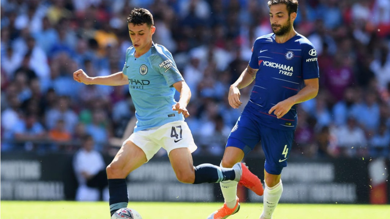 MIDDLE MARCH: Phil Foden looks to set up another City attack