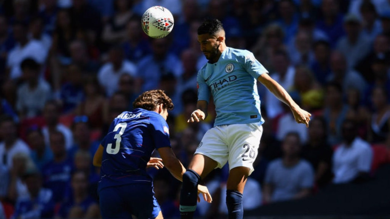 HEAD BOY: Riyad Mahrez gets an early taste of the action for City as he beats Marcos Alonso