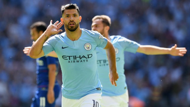 200 UP: Sergio Aguero starts the celebrations after netting his 200th goal for City