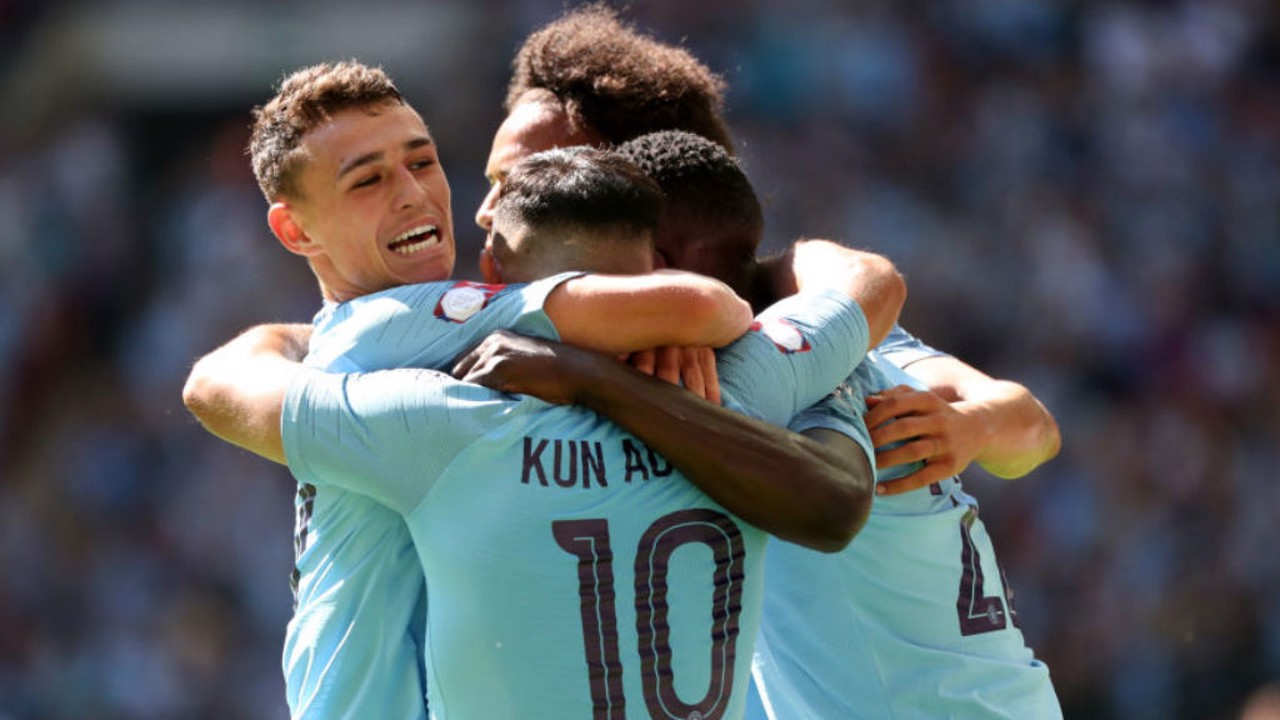 ALL SMILES: Phil Foden leads the celebrations after Sergio Aguero netted his 200th goal for City