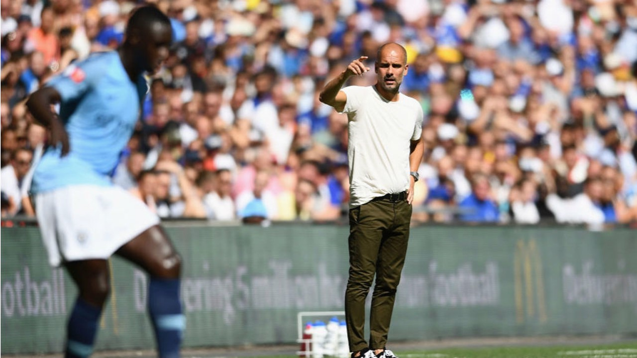 PEP TALK: City boss Pep Guardiola passes on instructions to Benjamin Mendy