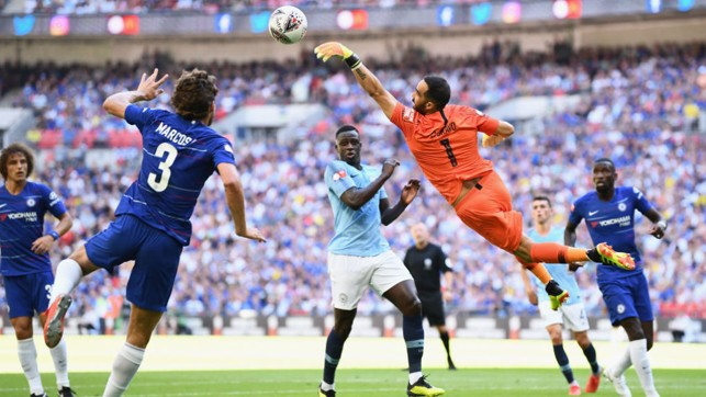 HELPING HAND: Claudio Bravo leaps high to avert the danger from a Chelsea attack
