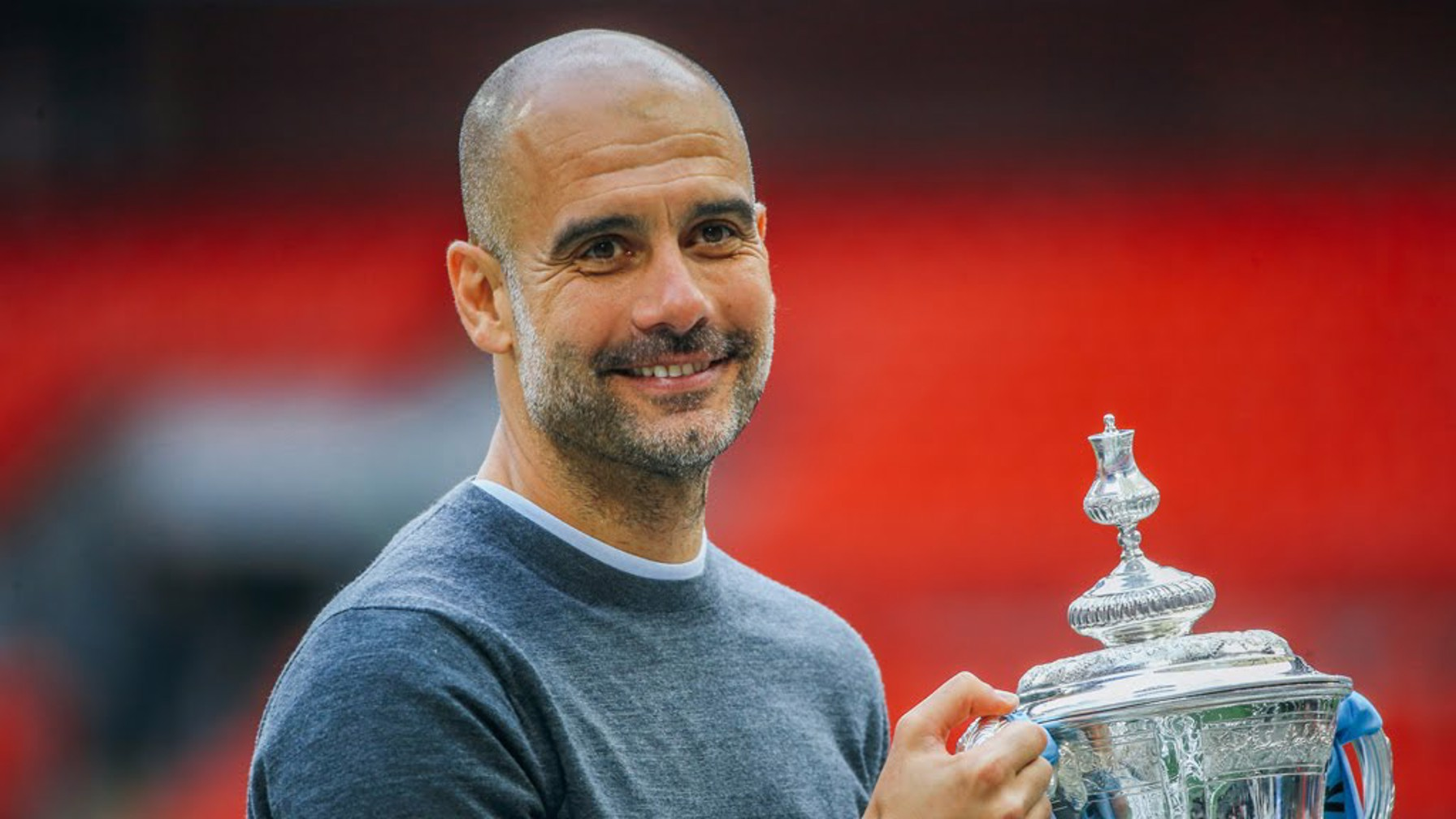 GUARDIOLA GRIN: Pep gets his hands on the cup