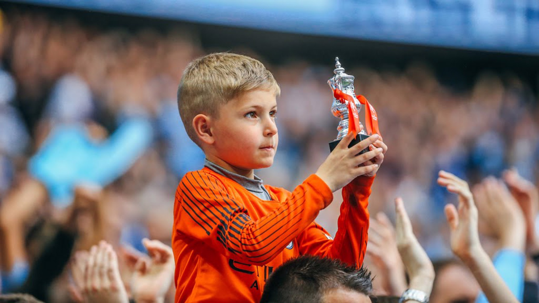 TROPHY LIFT: Little cup for a little Blues fan!