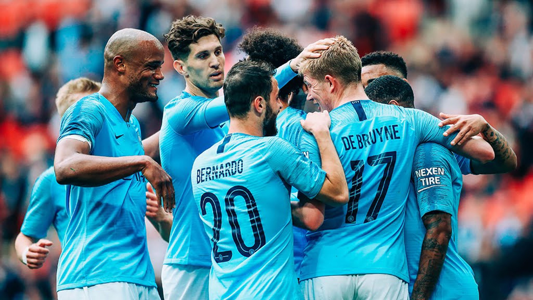DE BRUYNE DELIGHT: The team congratulate the Belgian for his goal