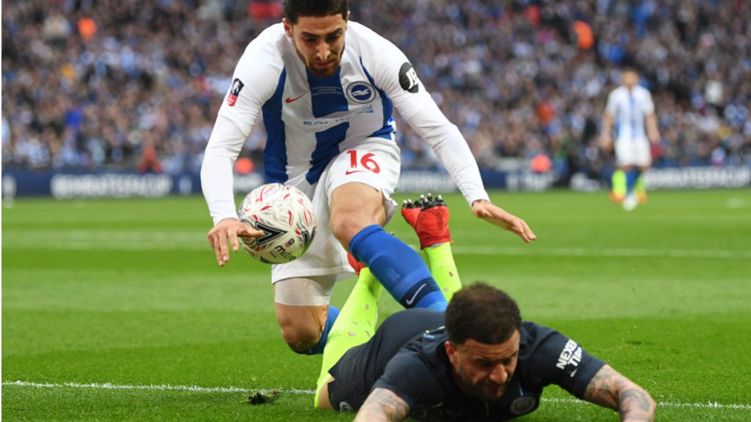 FLASHPOINT: Kyle Walker is sent crashing by Alireza Jahanbakhsh -an incident that sparked a melee which saw both players booked