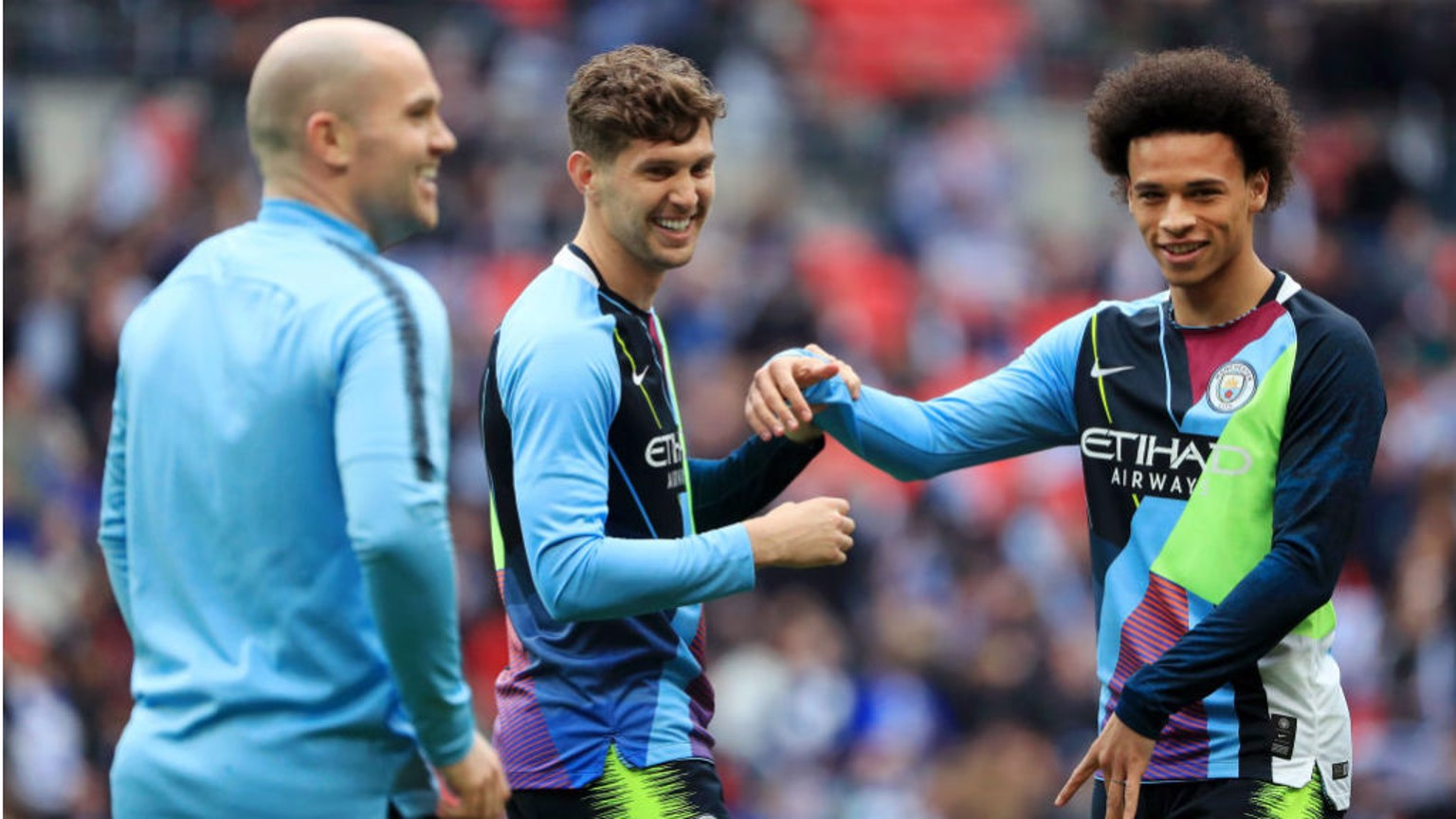 MASH IT UP: John Stones and Leroy Sane both cut quite a dash during the warm-ups in our Nike celebration mash-up jersey