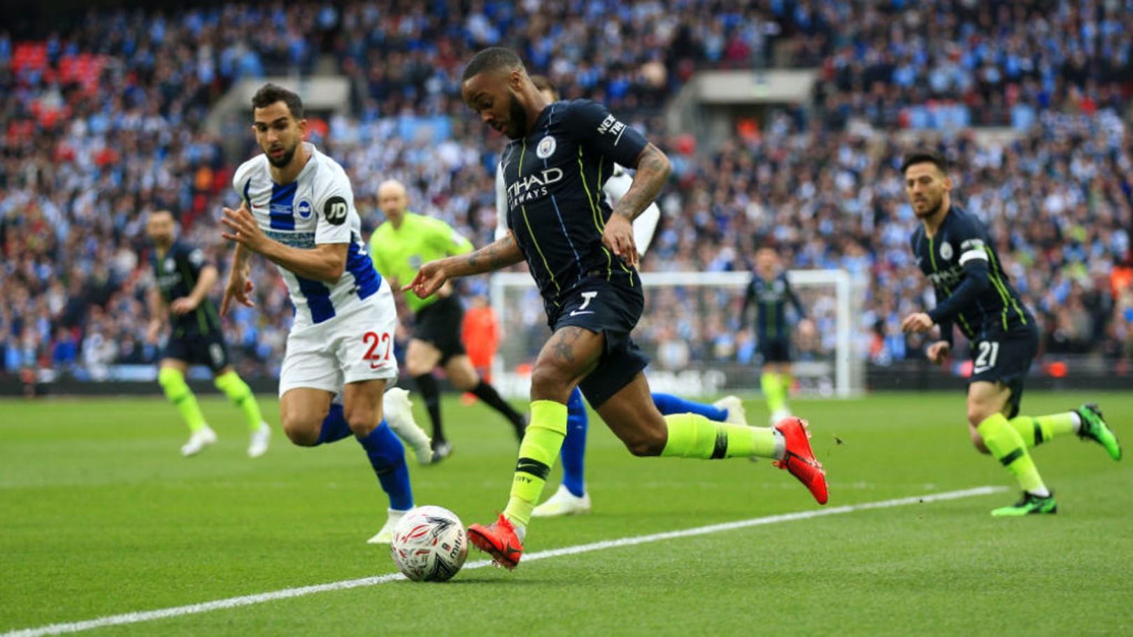 RAZZLE DAZZLE: Raheem Sterling takes on the Brighton defence