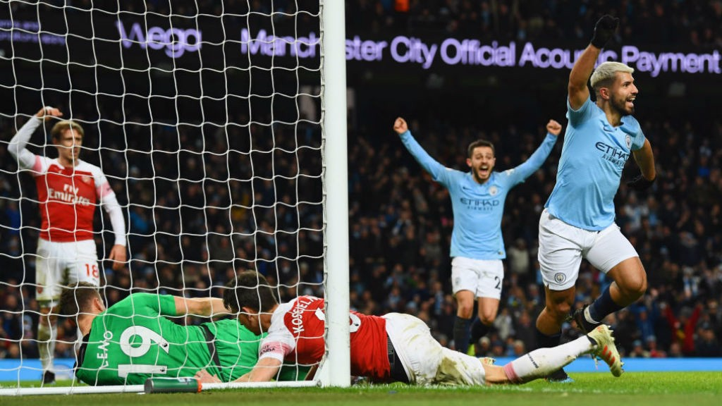 OUT OF SIGHT: Aguero scrambles the ball over the line to secure hat-trick.