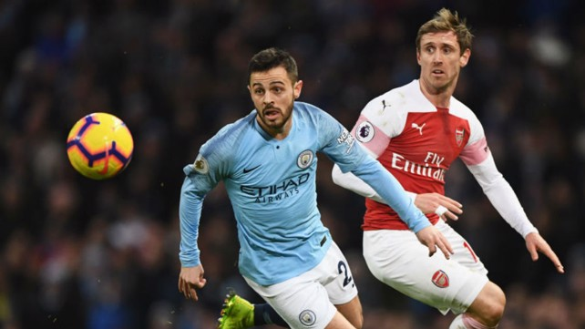 GREASE LIGHTNING: Bernardo zooms past Nacho Monreal.