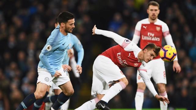 SPANISH WAR: David Silva and Denis Suarez battle in midfield.