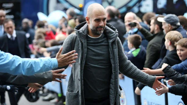 BOSS MAN: Pep arrives at the Etihad to a rapturous reception.