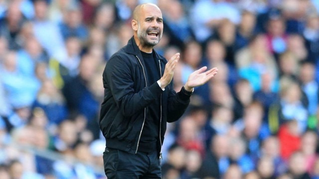 CLAP YOUR HANDS: Pep tries to get his team going from the sidelines