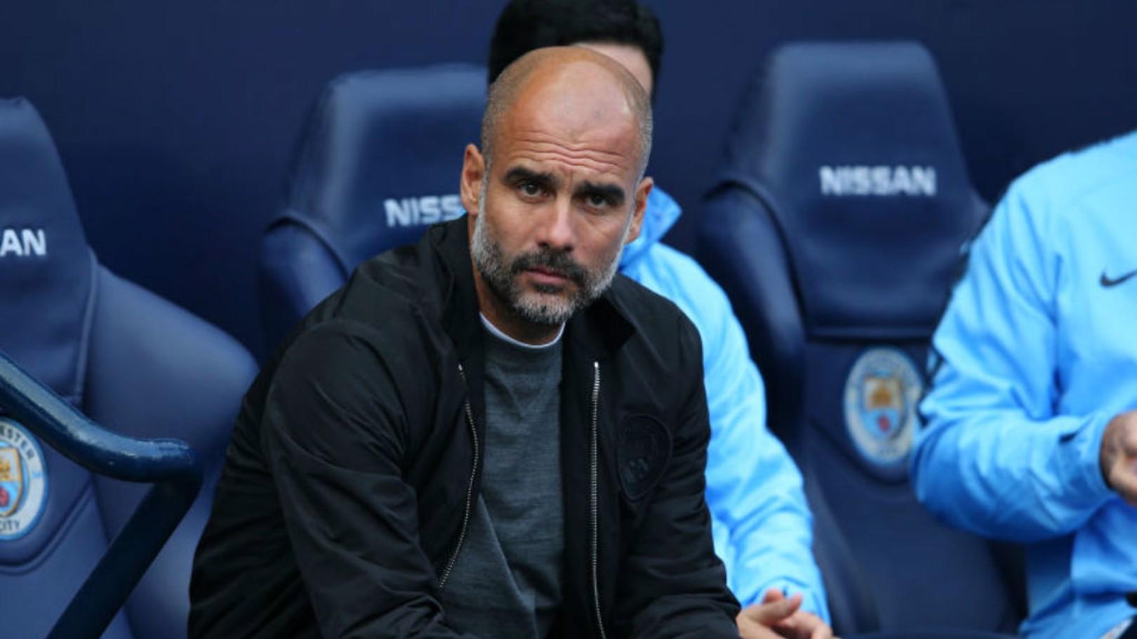WATCHING BRIEF: Pep Guardiola keeps an eye on proceedings during the game against Burnley