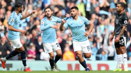 LETHAL WEAPON: Sergio Aguero wheels away in delight after opening the scoring