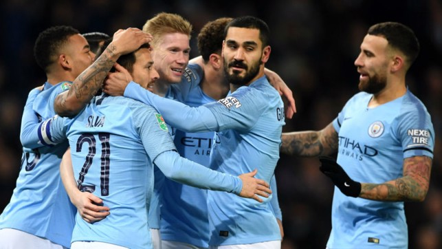 CENTRE OF ATTENTION: The Blues are all smiles after KDB's header