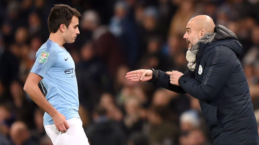 PEP TALK: The boss hands out some advice to birthday boy Eric Garcia, who was celebrating his 19th birthday