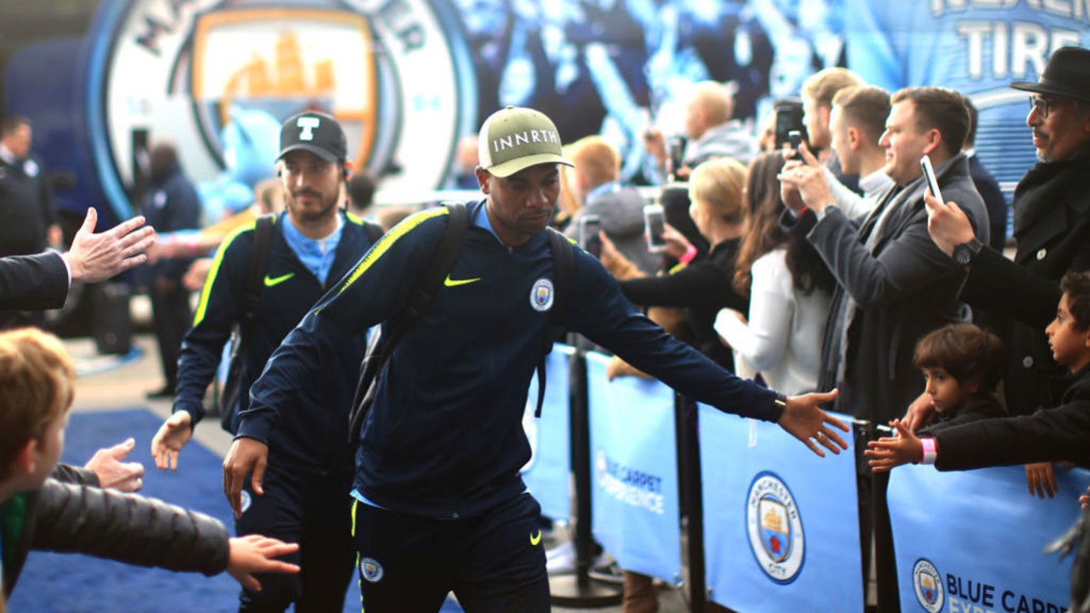 HATS THE WAY TO DO IT: The fans greet Fernandinho and David Silva as City arrive at the Etihad