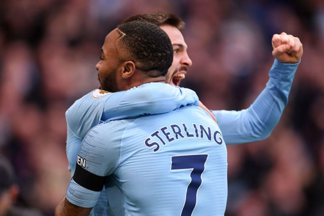1-0: Raheem Sterling celebrates his first goal of the game with Bernardo Silva.