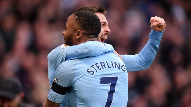 1-0: Raheem Sterling celebrates his first goal of the game with Bernardo Silva.