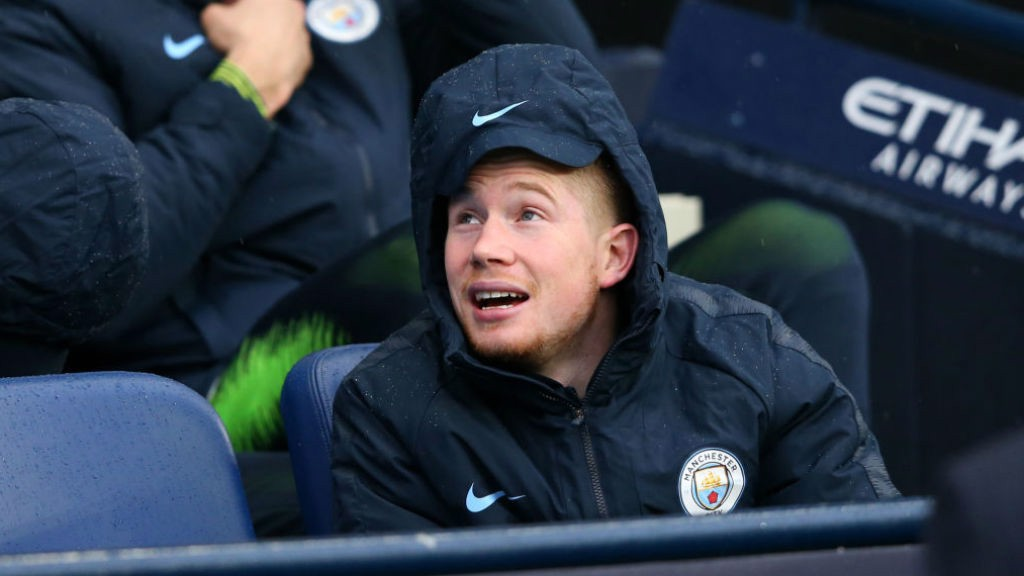 KEV IN THE HOOD: Kevin De Bruyne is wrapped up against the bitter December elements