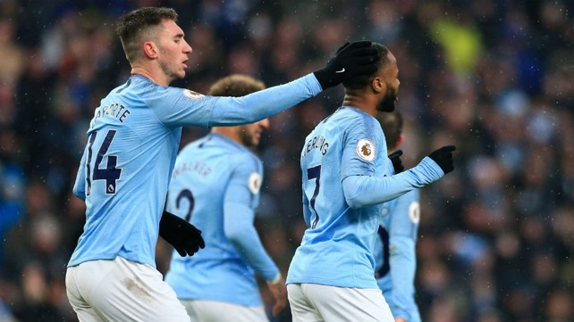 DUO: Aymeric Laporte congratulates m Sterling after he nets City's third.