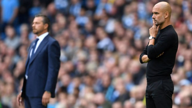 DUGOUT VIEW: The two managers watch on