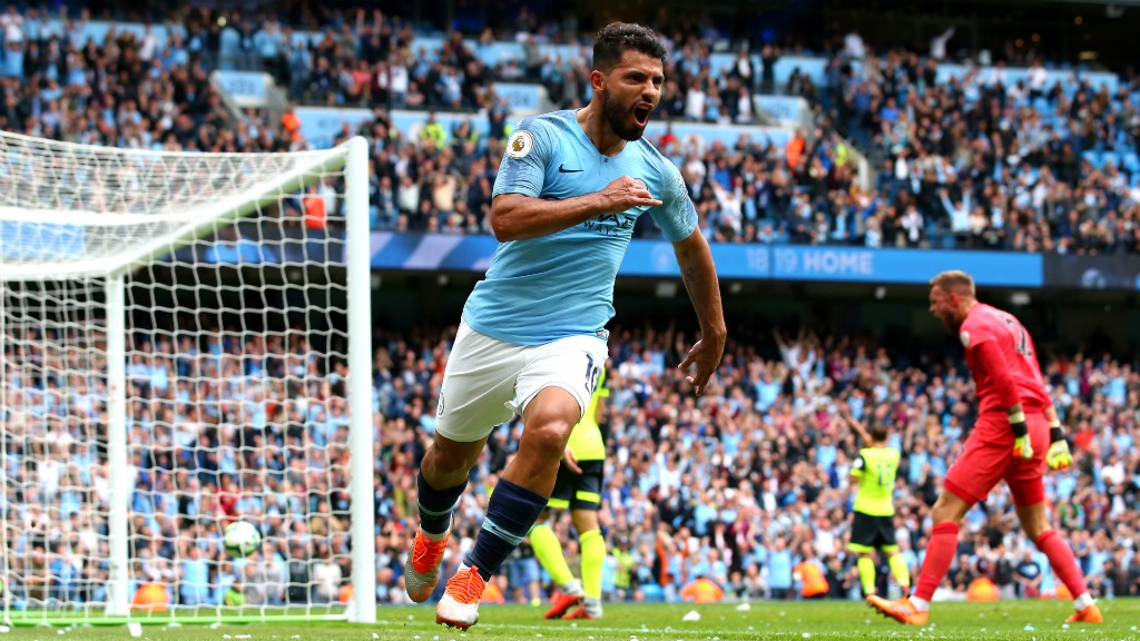 AT THE DOUBLE: Sergio Aguero wheels away, having bagged the rebound after Ben Hamer spilled Benjamin Mendy's cross