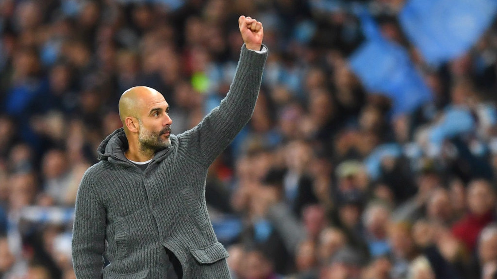 SALUTES: Pep Guardiola acknowledges the Etihad Stadium crowd.