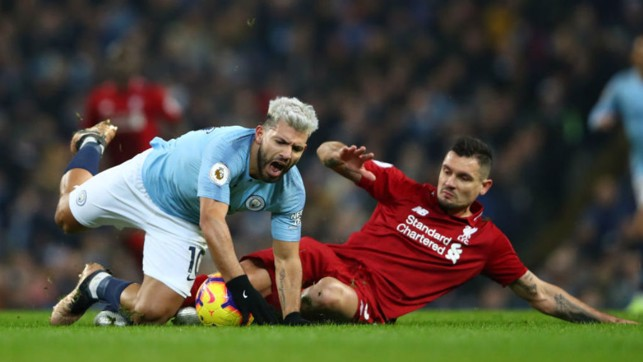 STOP START: Sergio Aguero is brought down by Dejan Lovren