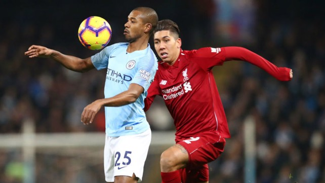 BRAZILIAN BLEND: Fernandinho shields the ball from Brazil team-mate Roberto Firmino
