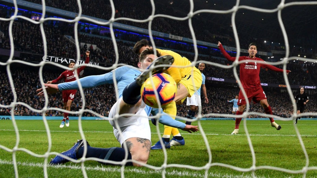 NICK OF TIME: John Stones stops Liverpool scoring by the narrowest of margins