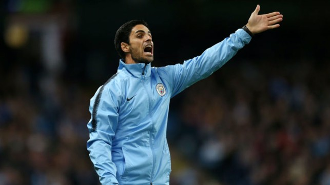 SHOUTING THE ODDS: Mikel Arteta passes on instructions to the City players