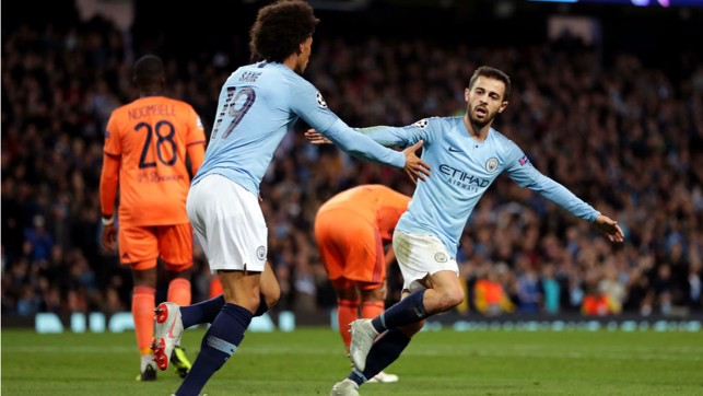GAME ON: Bernardo Silva celebrates his goal with Leroy Sane