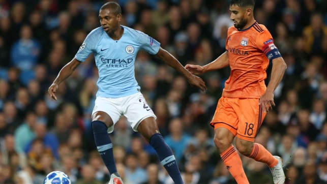 MIDDLE MARCH: Fernandinho takes on Lyon's Nabil Fekir