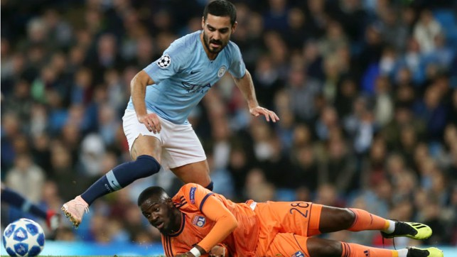 G FORCE: Ilkay Gundogan looks to power through the Lyon defence