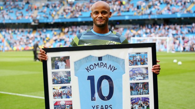 DECADE: Vincent Kompany received his gift for 10 years at the club before kick-off.