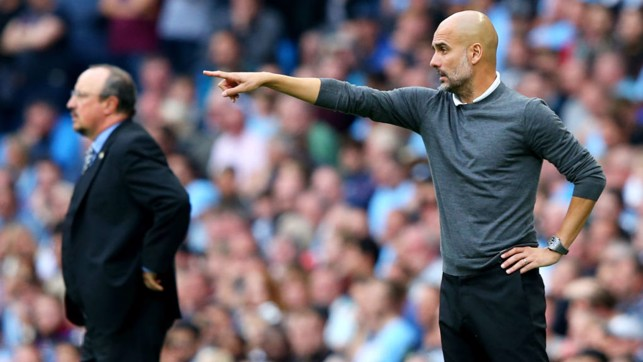 BOSS: Pep Guardiola gives instruction from the sideline.