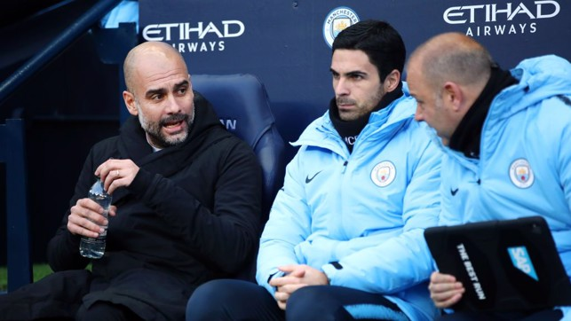 PEP TALK: The boss and his staff watch on from the dugout