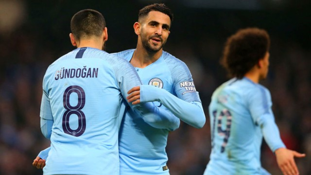 HIGH FIVES: Riyad Mahrez celebrates with Ilkay Gundogan after putting City 5-0 up