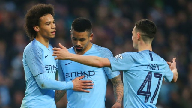 SEVEN UP: Leroy Sane is congratulated after his late strike