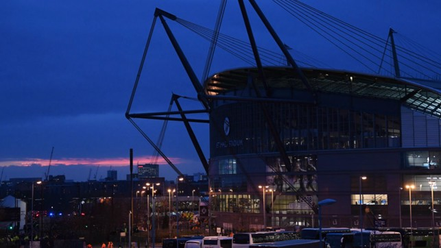 THE STAGE IS SET: The Etihad Stadium, silhouetted by a beautiful backdrop