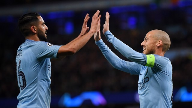 HIGH FIVE: Riyad Mahrez congratulates David Silva on his opener