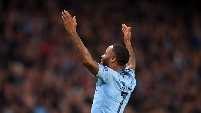 GOALDEN BOY: Raheem take the crowd's acclaim after curling home the third of the night