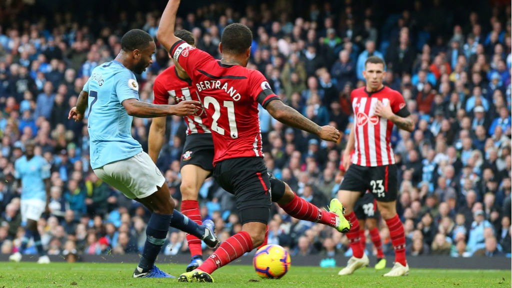 STER CRAZY: Raheem Sterling drills home City's fourth goal on the stroke of half-time