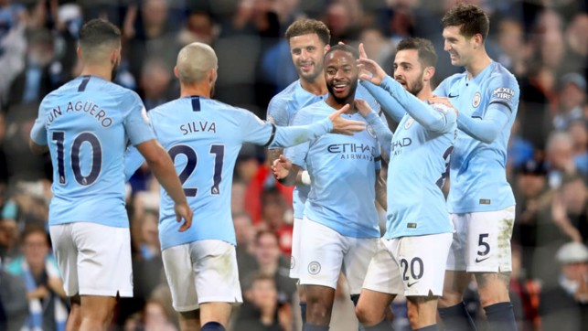 HIGH FIVES: Raheem Sterling takes the plaudits from his City team-mates after scoring our fifth goal